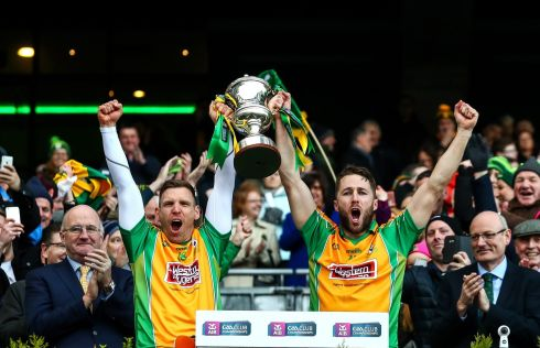 CROKER GLORY: Corofin's Ciaran McGrath and Michael Lundy lift the Andy Merrigan Cup after their win over Dr Crokes in the All-Ireland Senior Club Football Championship Final at Croke Park. Photograph: James Crombie/Inpho