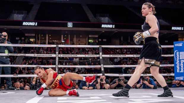 Katie Taylor knocks Rose Volante to the ground. Photograph: Tom Hogan/Inpho