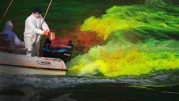 Workers dye the Chicago River green in Chicago, Illinois. Photograph: Scott Olson/Getty Images