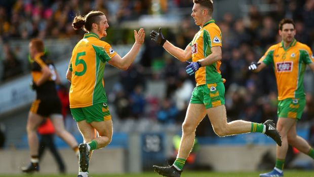 Corofin's Jason Leonard celebrates scoring his side's first goal with Kieran Molloy. Photograph: James Crombie/Inpho
