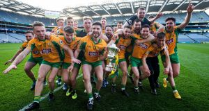 The Corofin team celebrate with the the Andy Merrigan Cup. Photograph: Tommy Dickson/Inpho