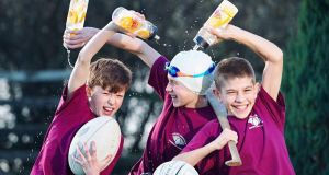 Graham Ball, Darragh Ball and Iarlaith McElroy at the launch of the Doora Barefield Community Games new waste reduction initiative: a reusable water bottle. Photograph: John Kelly