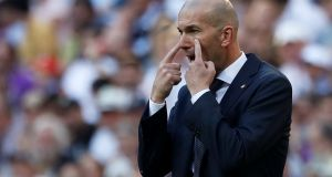New Real Madrid coach Zinedine Zidane during Saturday's game  against Celta Vigo.  Madrid are reported to be willing to spend up to €300m this summer. Photograph: Reuters/Susana Vera