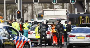 Emergency services stand at the 24 Oktoberplace in Utrecht, on Monday where a shooting took place. Photograph:  Robin van Lonkhuijsen/AFP/Getty Images