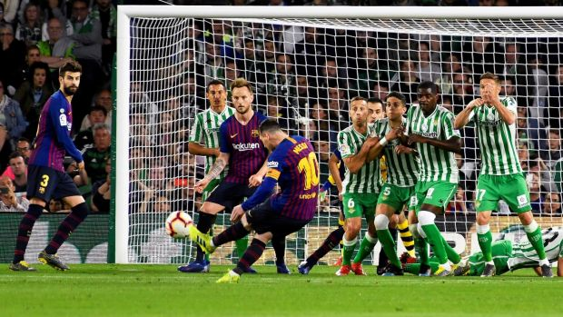Lionel Messi opened the scoring with a free kick so good that the commentary on French TV was soon doing the rounds on the net: there was nothing left to say, so they just laughed. Photograph: Raul Caro/EPA