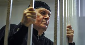Oyub Titiev, the head of human rights group Memorial in Chechnya, at his verdict hearing at a court  in Chechnya. Photograph: Said Tsarnayev/Reuters