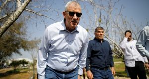 Benny Gantz, one of the leaders of  Blue and White, leans forward  during a visit to Kibbutz Kfar Aza, outside the northern Gaza Strip, in southern Israel. Photograph: Amir Cohen