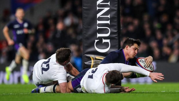 Sam Johnson scores a try to give Scotland the lead in the Six Nations game against Scotland at Twickenham. Photograph: Ryan Byrne/Inpho