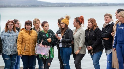 MISSING WOMAN: A group of women who had joined a St Patrick's night hen party wait on the pier in Carlingford, Co Louth, for news after one of their number, Ruth Maguire, went missing overnight. The Garda on Monday confirmed the body of a woman subsequently discovered in the water was that of Ms Maguire. Photograph: Ciara Wilkinson