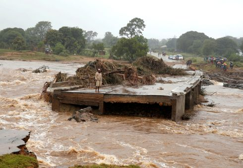 STORM SURGE: A man observes the damage at a bridge that was washed away by flooding on the Umvumvu river in Chimanimani, Zimbabwe. At least 98 people were killed and another 200 are missing after regional storms, authorities say. Photograph: Philimon Bulawayo/Reuters