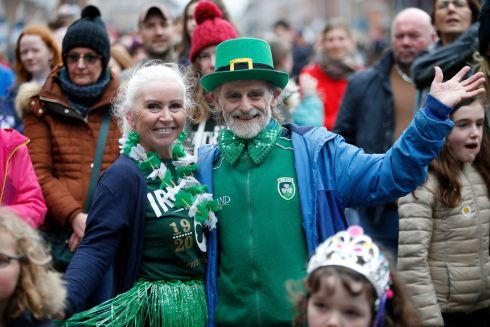 GOING GREEN: Christine and Jimmy Reddington, from Dublin, enjoying the Céilí Mór, a free outdoor bilingual event  celebrating traditional Irish dance, language and music, held in Merrion Square on Monday. Photograph Nick Bradshaw