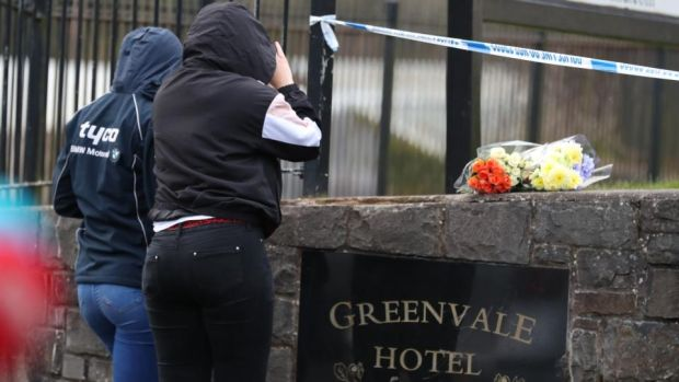 Flowers are left by a sign for the Greenvale Hotel in Cookstown, Co Tyrone. Photograph: Liam McBurney/ PA Wire