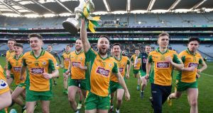 Corofin's Michael Lundy holds aloft the Andy Merrigan Cup after their victory over Dr Crokes in the All-Ireland senior club football championship final at Croke Park. Photograph: Tommy Dickson/Inpho