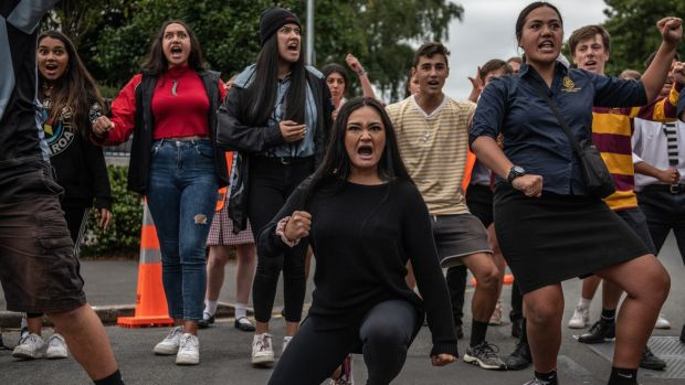 Students perform a haka during a vigil in memory of the victims of the New Zealand mosque attacks, near al-Noor mosque in Christchurch. Photograph: Carl Court/Getty Images