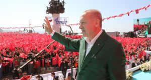 Turkey's president Recep Tayyip Erdogan  greets supporters during an AK Party  local election campaign rally in Izmir. Photograph: Turkish Presidential Press Service/AFP/Getty Images