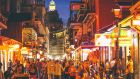 Bourbon Street is a hive of activity every night of the week, with live bands in every bar and children on the neon-lit streets bucket-drumming. Photograph: iStock