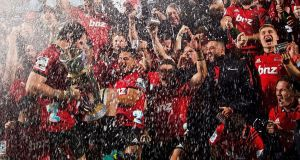 Crusaders' players celebrate their victory after the Super Rugby final last year. Photo: Marty Melville/Getty Images