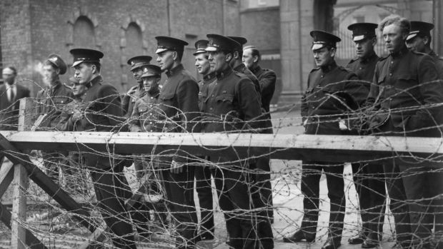 "Black and Tans and British army privates at the Four Courts in 1922. ""History will continue to be provided as a full subject to most students at Junior Cycle. But we don't need policed rules and enforced mandates to ensure that highly qualified professionals do their job."" Photo: Getty Images"
