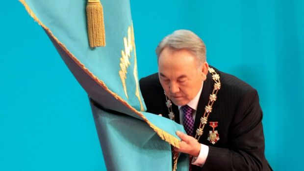 Kazakh president Nursultan Nazarbayev kisses the national flag during a swear-in ceremony in Astana. File photograph: Alexey Filippov/AFP/Getty Images