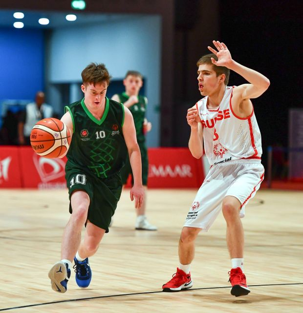 Team Ireland's Stephen Murphy in action against Emile Terrettaz of Switzerland during the male/mixed play-off round 1 basketball game. Photograph: Ray McManus/Sportsfile