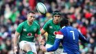 Jack Carty (left) in action for Ireland against   France in Dublin on March 10th.   Photograph: Billy Sticklan/Inpho