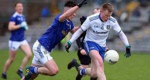 Cavan's Gerard Smith moves in to tackle Monaghan's Ryan McAnespie at Clones last Sunday. Photograph: John McVitty/Inpho