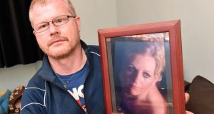 Richard Satchwell holding up a photo of his wife Tina at their home in Youghal. Photograph: The Irish Examiner