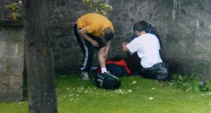 Drug users injecting across the road, in view of classes at St Audoen's National School. Photograph: Dara Mac Donaill