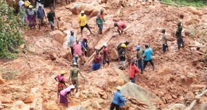 CYCLONE IDAI: People dig with their bare hands for a boy who was buried in mud during a landslide after Cyclone Idai in Chimanimani, about 600km southeast of Harare, Zimbabwe. Unknown hundreds of people are thought to be missing. Photograph: Tsvangirayi Mukwazhi/AP Photo