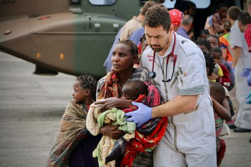 FAMILY RESCUED: People are escorted to safety by aid workers at an airport in the coastal city of Beira, Mozambique,  after the region was hit by Cyclone Idai. Rescue workers have been racing to pluck people off trees and rooftops in flooded areas after the storm resulted in the deaths of more than 1,000 people in the country. Photograph: Adrien Barbier/AFP/Getty