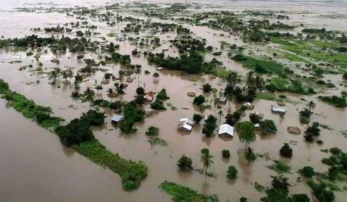 "MAROONED VILLAGE: Floodwater covers large tracts of land in Nicoadala, Zambezia Province, Mozambique after Cyclone Idai. Rapidly rising waters have created ""an inland ocean"" in the country, endangering many thousands of families, as aid organisations scramble to rescue and feed survivors. Photograph: World Food Programme/AP"