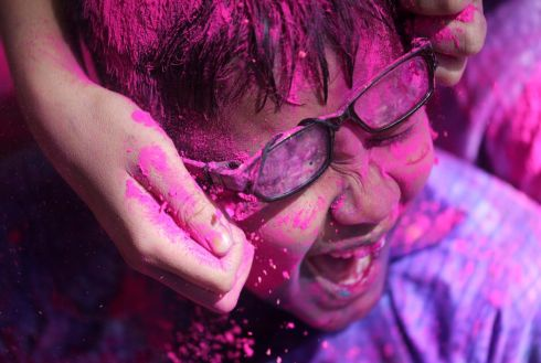 IN THE PINK: Children douse each other in coloured powders during Holi celebrations in Mumbai, India. Photograph: Francis Mascarenhas/Reuters