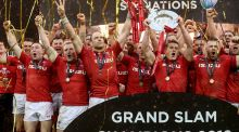 Alun Wyn Jones lifts the Guinness Six Nations trophy as Wales celebrate clinching the Grand Slam in Cardiff. Photograph: Dan Sheridan/Inpho