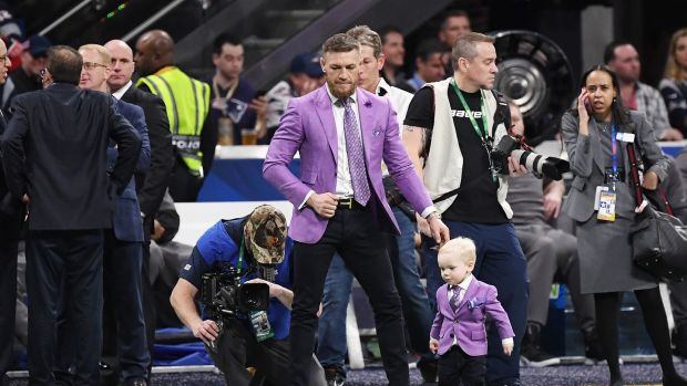 McGregor on the pitch with his son ahead of the Super Bowl in February. Photo: Harry How/Getty Images