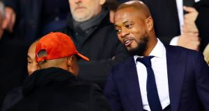 Patrice Evra with Samuel Eto'o in the stands before the Champions League last-16 match between Manchester United and PSG. Photo: Chris Brunskill/Fantasista/Getty Images
