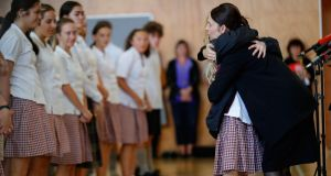 New Zealand's prime minister Jacinda Ardern hugs a student during a visit to a high school in Christchurch on Wednesday. Photograph: Vincent Thian/AP