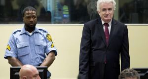 Former Bosnian Serb leader Radovan Karadzic  in court on Wednesday in The Hague, where a UN tribunal increased his sentence for war crimes from 40 years to life. Photograph:  Peter Dejong/AFP/Getty Images