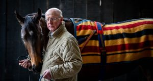 "John Oxx with 1,000 Guineas contender Skitter Skatter at Currabeg Stables on the edge of the  Curragh. ""She doesn't need much work so barring accidents she should be easy enough to get fit for Newmarket."" Photograph: Morgan Treacy/Inpho"