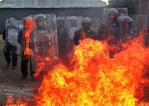 GREAT BALLL OF FIRE: Gardaí simulate a petrol bomb attack during a training excercise for the Garda Public Order Unit at Gormanstown Military Camp on Wednesday. Photograph: Colin Keegan/Collins Dublin