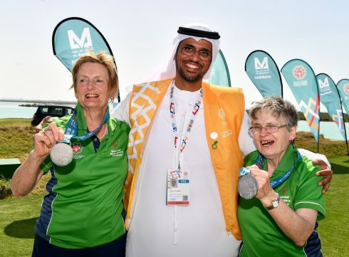 SPECIAL OLYMPICS: Volunteer Mansoor Ali Aljaberi with Team Ireland's Mairead Moroney from Ennis, Co. Clare, who has the distinction of being the oldest athlete at the games, and her Alternate Shot team play partner Jean Molony (left) after they had collected their silver medals in the level 2 Unified Alternate Shot Team Play Competition on day six of the 2019 Special Olympics World Games in Yas Links, Yas Island, Abu Dhabi. Photograph: Ray McManus/Sportsfile