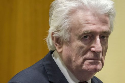 WAR CRIMES: Former Bosnian Serb leader Radovan Karadzic reacts at the court room of the International Residual Mechanism for Criminal Tribunals in The Hague, Netherlands, on March 20th,  while waiting to hear the final judgement on his role in the bloody conflict that tore his country apart a quarter of a century ago. Karadzic was sentenced to life imprisonment by UN judges on Wednesday. Karadzic  was notorious for his role in the 1995 Srebrenica massacre where more than 8,000 Muslim men and boys were slaughtered in the worst bloodletting on European soil since the second World War. Photograph: Peter Dejong/POOL/AFP/Getty