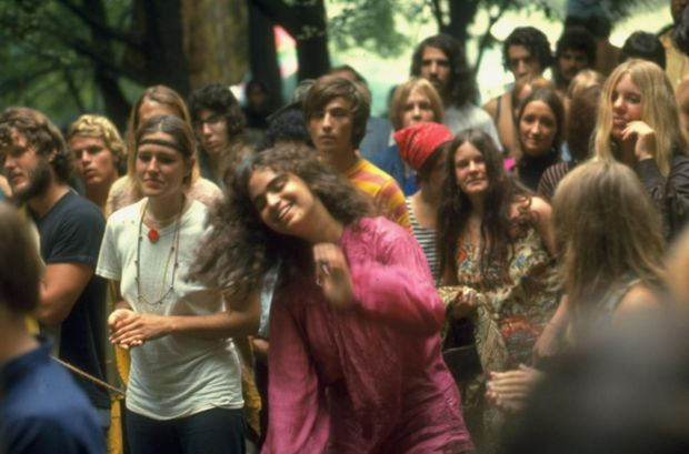 Psylvia, dressed in a pink Indian shirt, dancing in midst of the crowd, during Woodstock. Photograph: Bill Eppridge/The LIFE Picture Collection/Getty