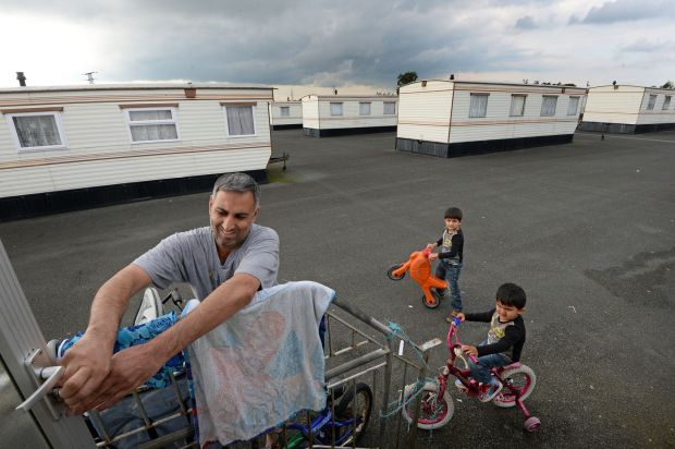 Photograph from October 2016 at the accommodation centre where the Idris family lived for nearly 12 years. Pictured are Ahmed Idris and his sons Anas and Soban. Photograph: Eric Luke/The Irish Times