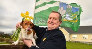 Mike O'Donoghue, along with his dog 'Buddy',  at his home in Pallasgreen, Co Limerick, prior to his all-day fundraiser for Daffodil Day 2019. Photograph: Diarmuid Greene