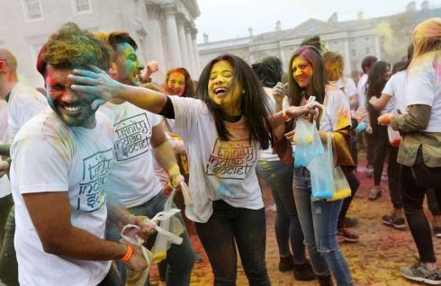 Trinity College Dublin students participate in this year's Holi, Festival of Colours. Celebrations are in the Front Square organised by the Trinity Indian Society. Photograph: Laura Hutton/The Irish Times
