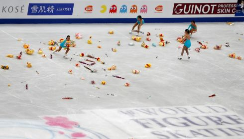ISU World Figure Skating Championships at the Saitama Super Arena, Saitama, Japan. Volunteers remove Winnie the Pooh toy bears and other items from the ice after Japan's Yuzuru Hanyu's performance. Photograph: Issei Kato/Reuters