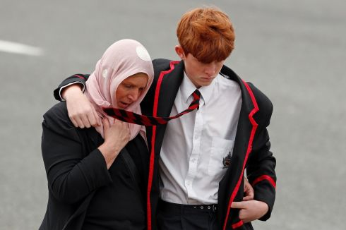 A student and a woman attend the burial ceremony of a victim of the mosque attacks, at the Memorial Park Cemetery in Christchurch, New Zealand. Photograph: Edgar
