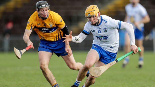 Waterford's Peter Hogan takes on Clare's Jack Browne of Clare. Photograph: Laszlo Geczo/INPHO