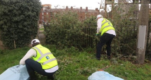 Volunteers from A Way to Happiness carry out clean up work in the Guild Street area of Dublin's north inner city. Photograph: Dublin City Council