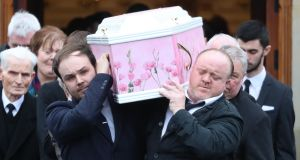 The coffin of Lauren Bullock is taken from St Patrick's Church, Donaghmore. Photograph: Liam McBurney/PA